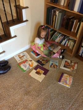 Eliza reading books on Sunday mornning