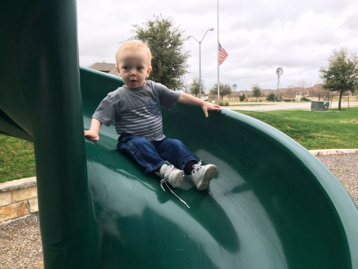 James was brave to go down the slide by himself.