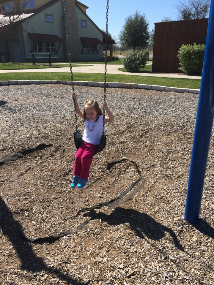 Eliza loves swinging