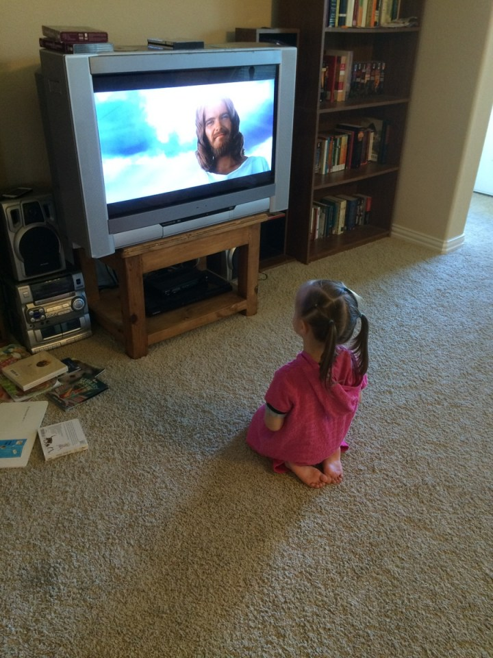 "Eliza watching ""the Jesus movie."""
