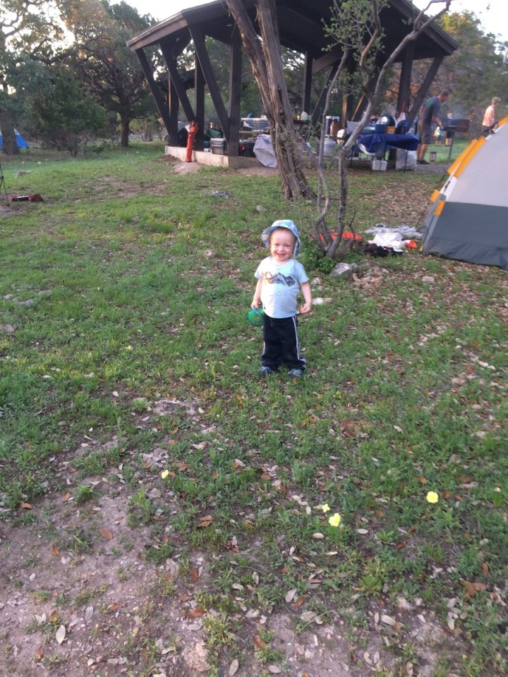 James loves camping. He was always asking to beput down so he could walk around.