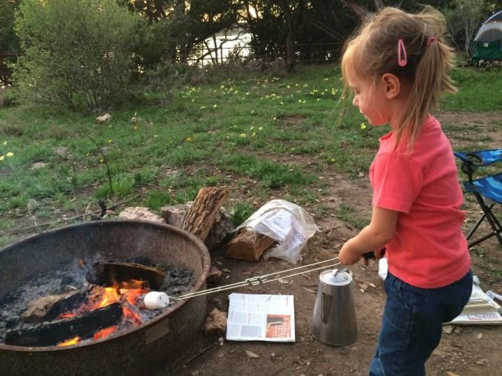 Eliza roasting her marshmallow.