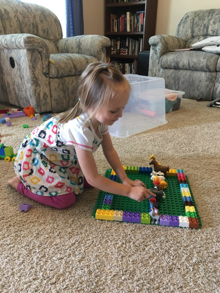Eliza making a duplo farm.