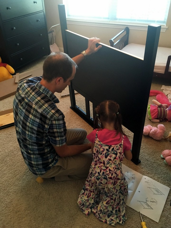 Eliza and Daddy building her bed.