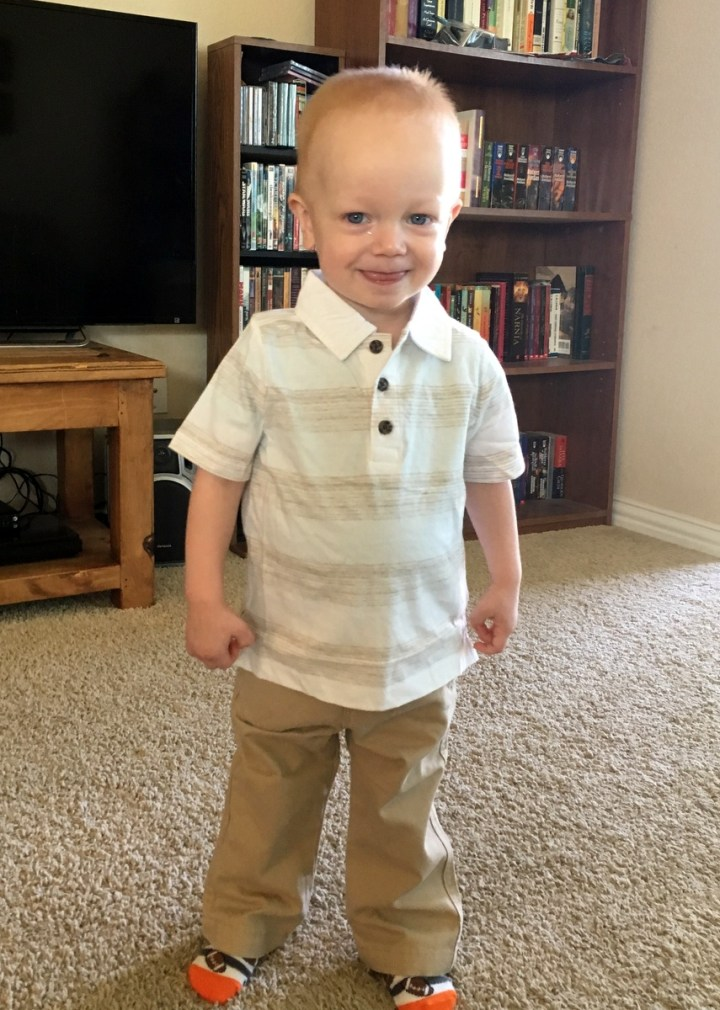 James modeling his clothes for the family picture.