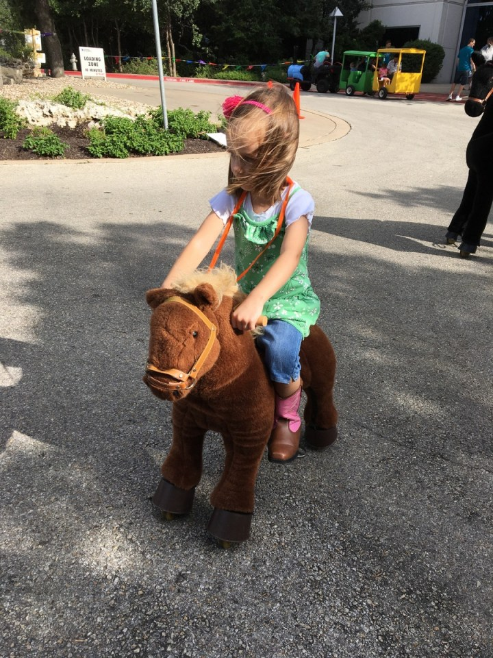 Riding the horse.