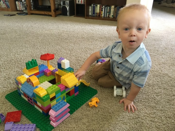 James playing with duplos