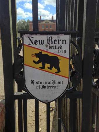 New Bern sign with Tryon Palace in the background