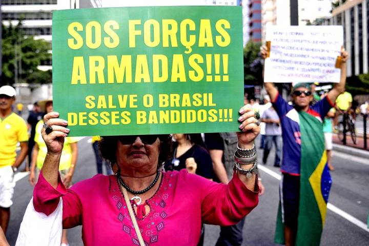 "Protest sign reads ""SOS Forcas Armadas!!! Salve o Brasil desses Bandidos!!!"""