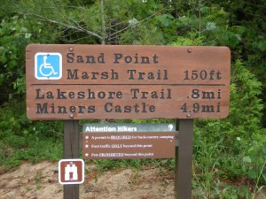 Photo of the sign leading to the Sand Point Marsh Trail in Pictured Rocks National Lakeshore