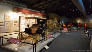 Old Wade House - Various carriages and Frank Lloyd Wright exhibit in background