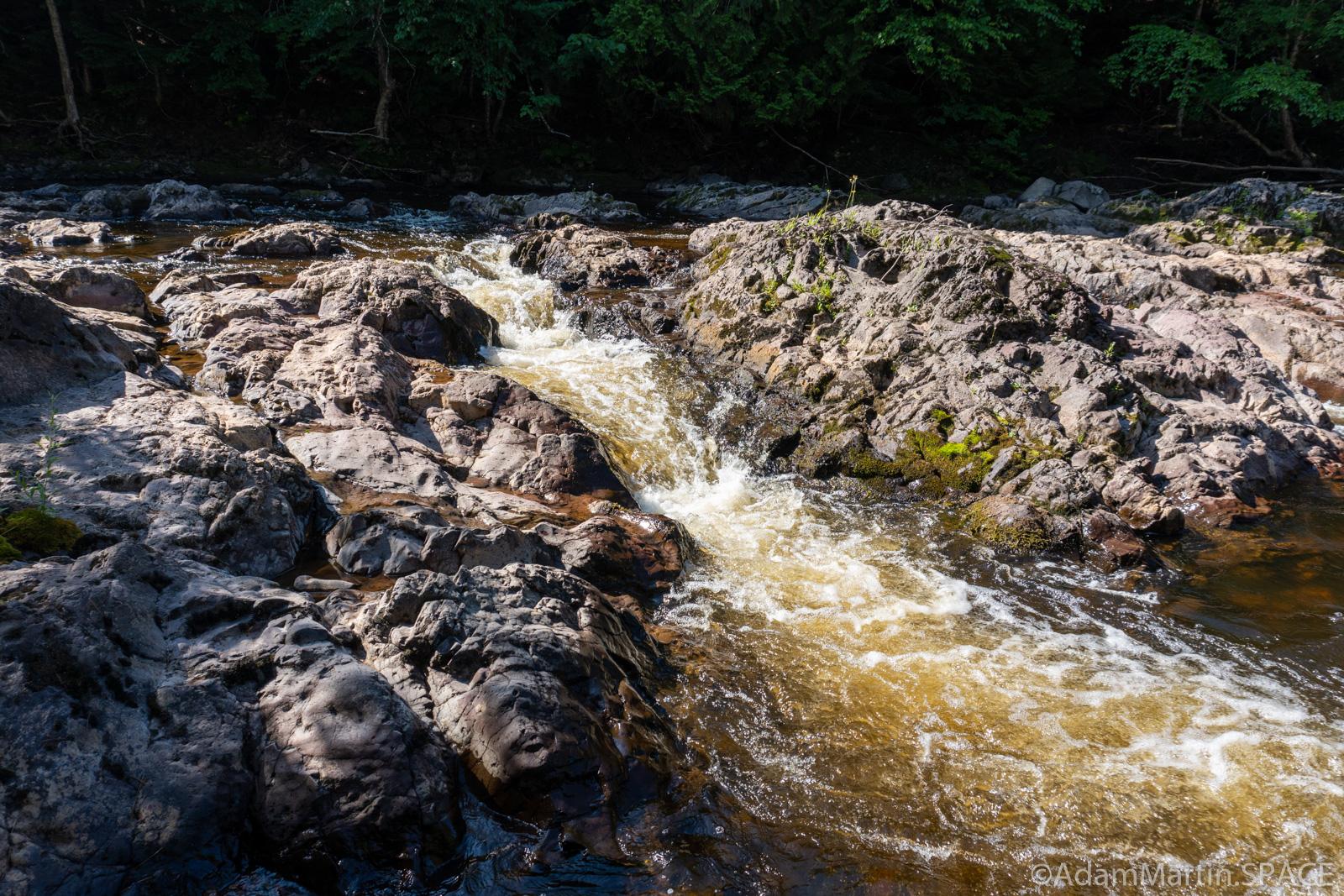 Potato River Dalles - Waterfall tunneling through rocks