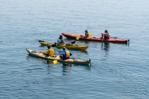 Big Bay State Park - Kayaks stopping on Point Trail coast