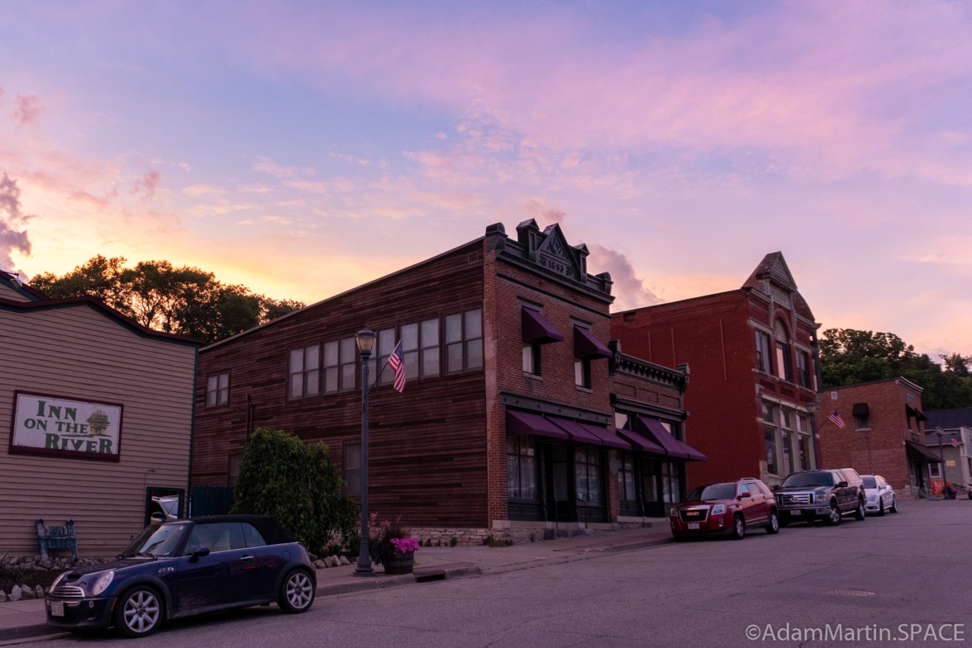 Trempeauleau, WI - Sunset over Main Street buildings
