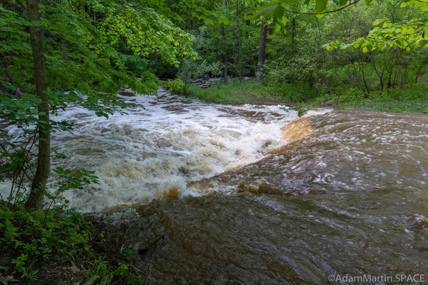 Baird Creek - Looking over top the upper falls