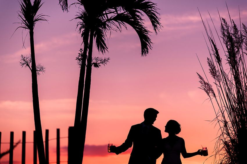 creative beach wedding photos at the Dewey Lions Club by Washington DC Wedding Photographer Adam Mason