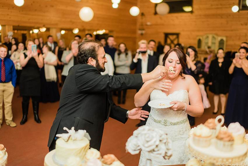 cake cutting fails at barn at klines wedding by Washington DC Wedding Photographer Adam Mason
