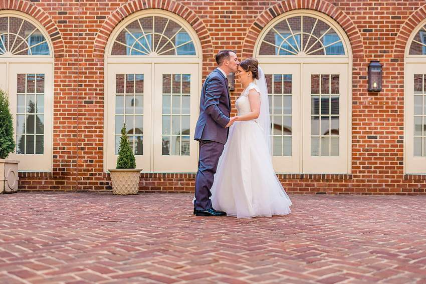 bride and groom during Alexandrian Hotel Wedding in Old Towne Alexandria by Washington DC Wedding Photographer Adam Mason