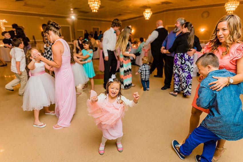 fun dancing at urbana hall wedding by Washington DC Wedding Photographer Adam Mason