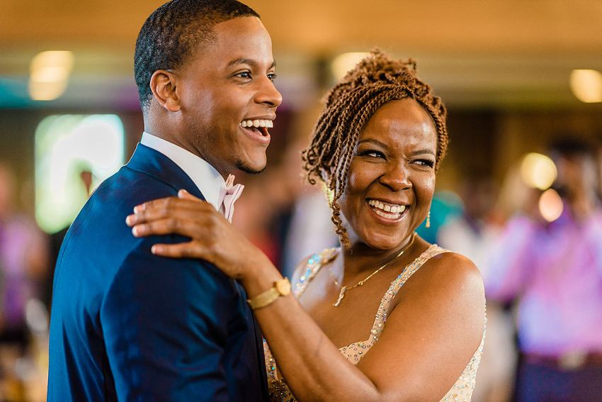mother son smiling during dance at wyndridge farm wedding by Washington DC Wedding Photographer Adam Mason