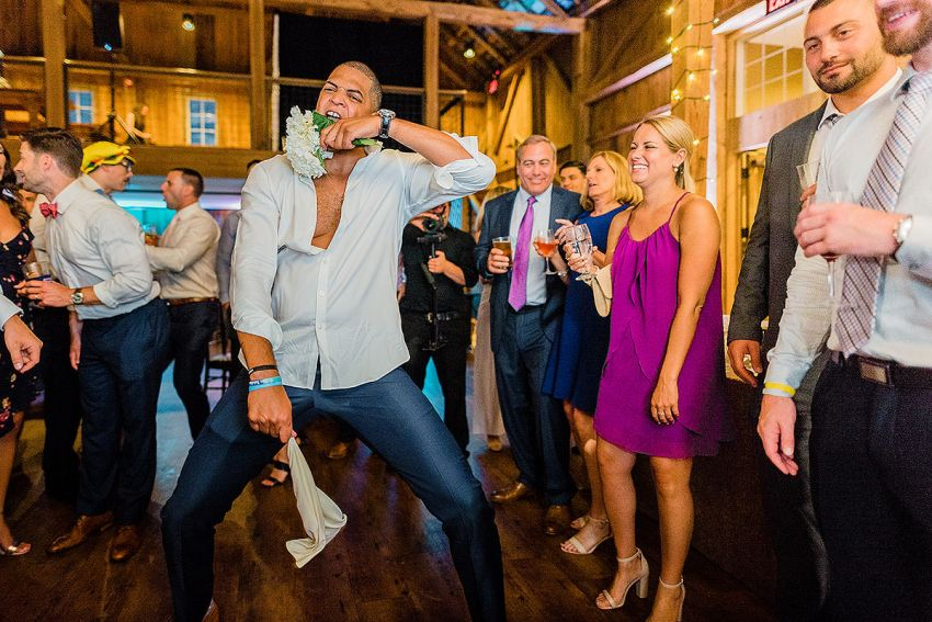crazy groomsmen at wedding by Washington DC Wedding Photographer Adam Mason