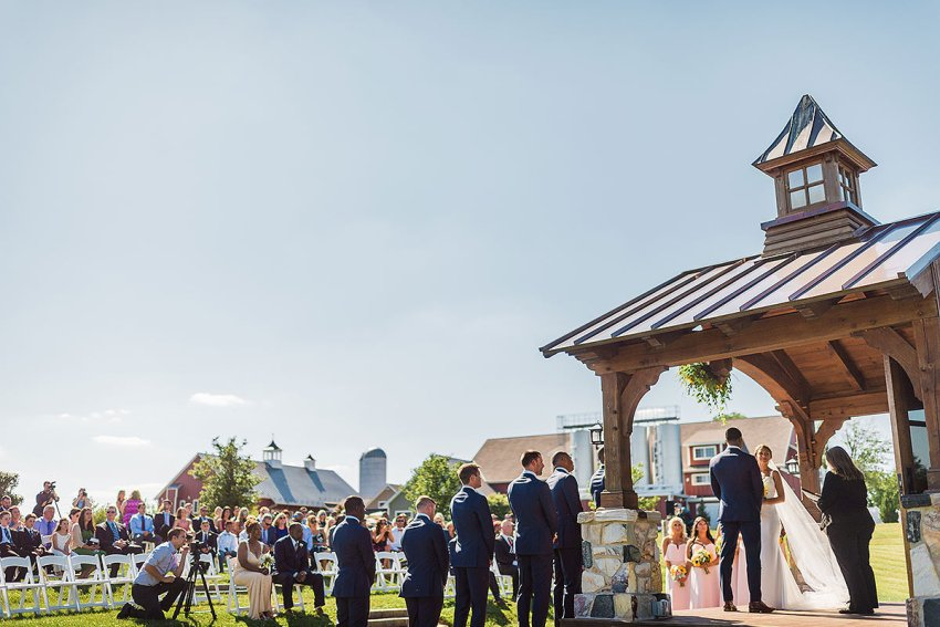 outdoor wedding ceremony at wyndridge farm by Washington DC Wedding Photographer Adam Mason