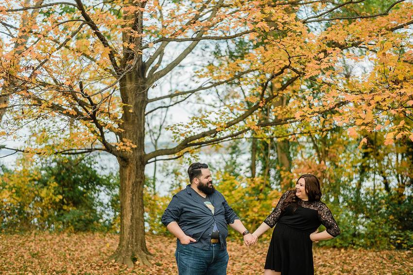 couple laughing at river farm engagement session during Fall by Washington DC Wedding Photographer Adam Mason