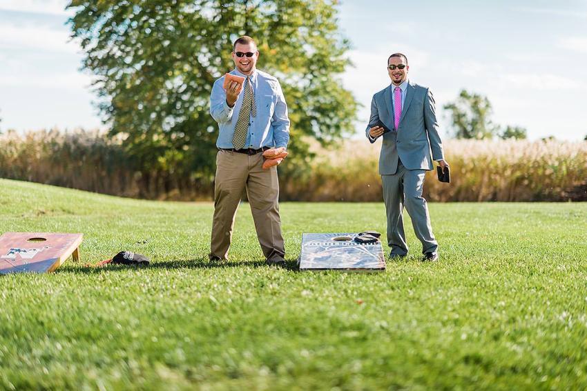 cornhole and wedding games at thousand acre farm wedding by Washington DC Wedding Photographer Adam Mason