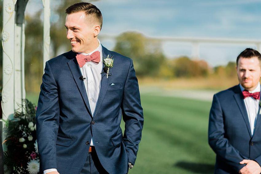 groom being excited at thousand acre farm wedding by Washington DC Wedding Photographer Adam Mason