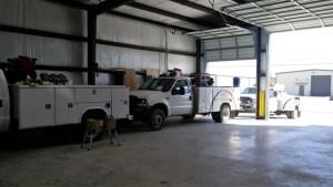 Adams Mobile Air trucks at shop