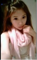 Xiao Tian with hand on mouth wearing a pink scarf