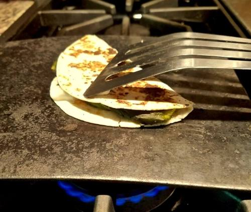 Quesadilla requires medium heat on a comal to turn the exterior crispy.