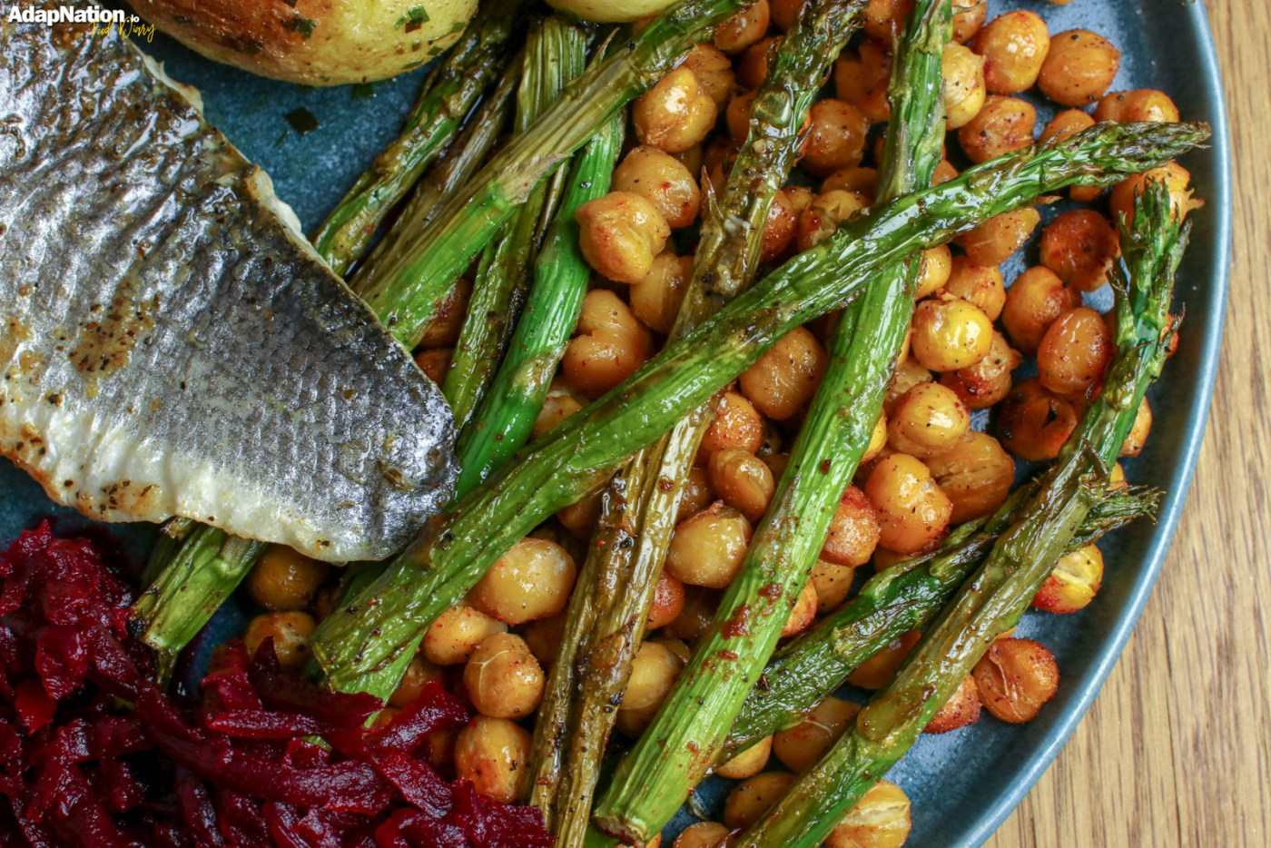 Pan Fried Sea Bass, with Spicy Chickpeas & Asparagus, Smoky Beetroot & Buttery New Potatoes