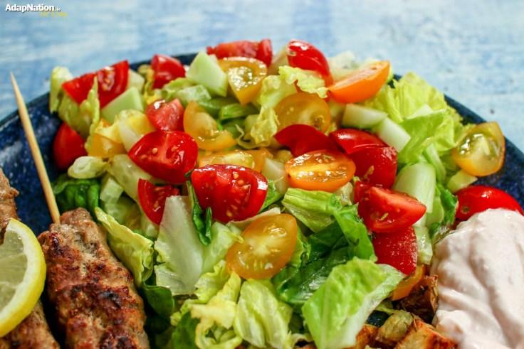 Lamb Adana Kebabs, Crispy Roasties, Halloumi & Salad p4