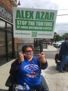 ADAPT activist protesting JRC