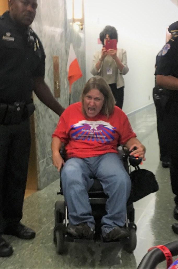 Shouting in her wheelchair in police custody