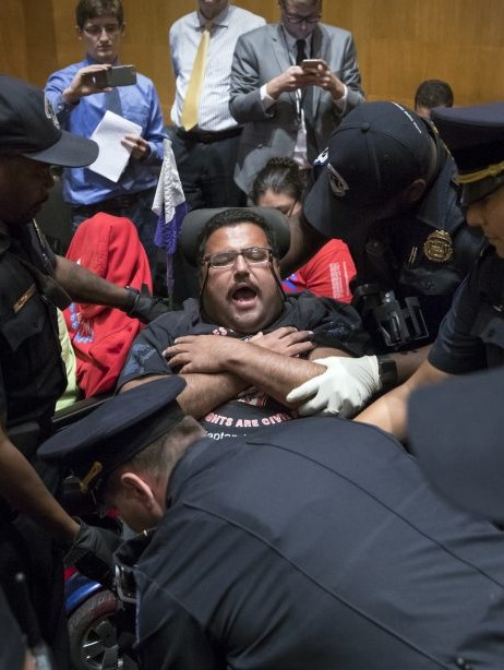 In his wheelchair surrounded by police