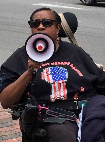 In her wheelchair with a megaphone