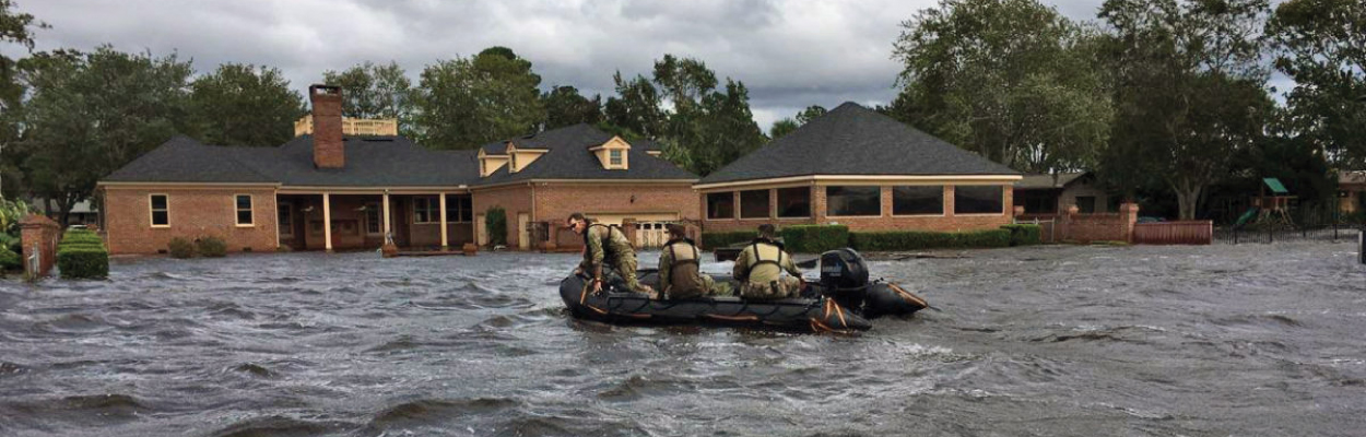Florida National Guard in a boat respond to flooding in Ortega Jacksonville from Hurricane Irma.