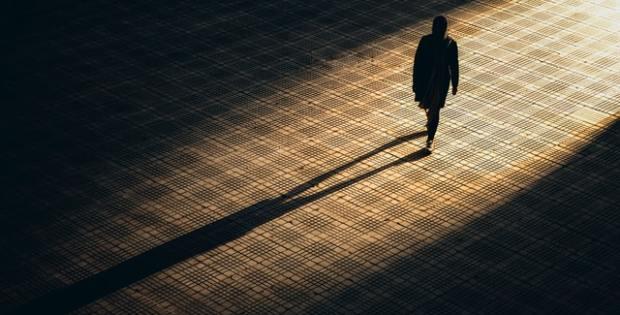 Person in shadows