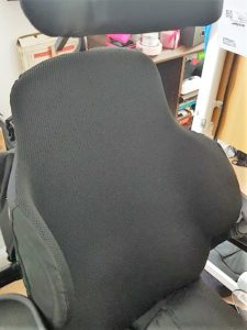 The backrest of my electric wheelchair, with bits sticking out which contour round my torso to support it better