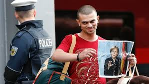 migrant with merkel picture