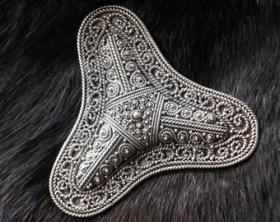 intricate viking brooch
