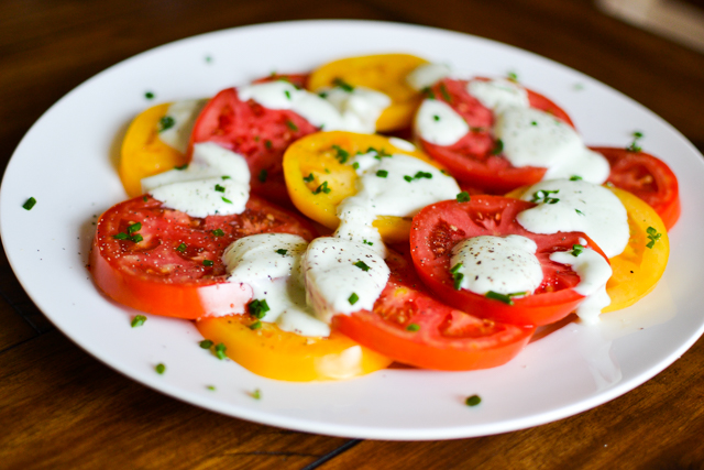 Fresh tomato salad with a tangy greek yogurt dressing!