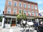 A horse-drawn carriage passes the most preppy Ben Silver clothing shop on King Street.