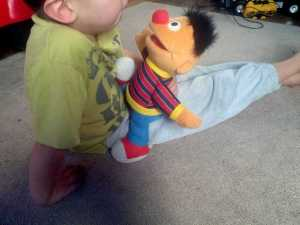 Here's Kevin, enjoying his new doll.