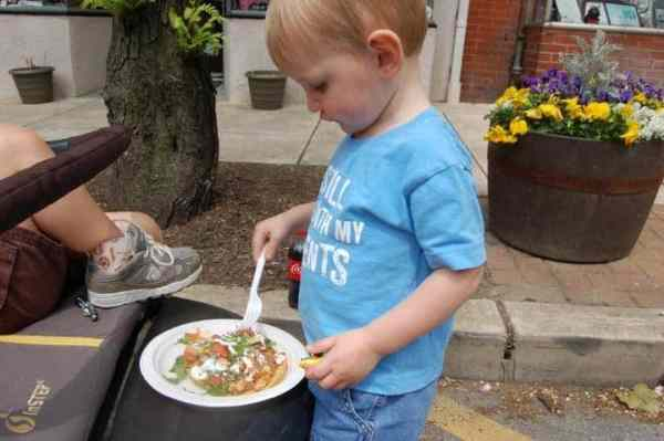I show this to him often--him eating a chicken tostada at a Cinco de Mayo Festival. He used to eat anything!