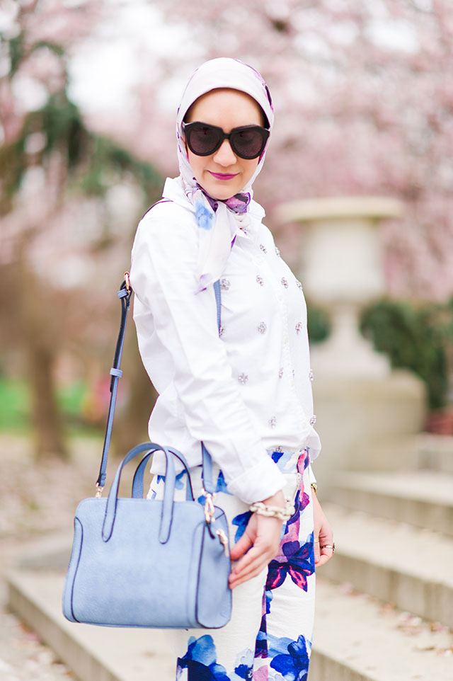 Banana Republic Watercolor Floral Pants; Spring; Floral Pants; Haute Hijab; Fashion Blog; Baltimore Patterson Park; Patterson Park Pagoda Hill; HIjabi; Urban Expressions Skyler Bag; Pastel; Jewelled Oxford Shirt; Colored Heels; Ily Cotoure Bracelet; Karen Walker Sunnies; Cherry Blossom Photos