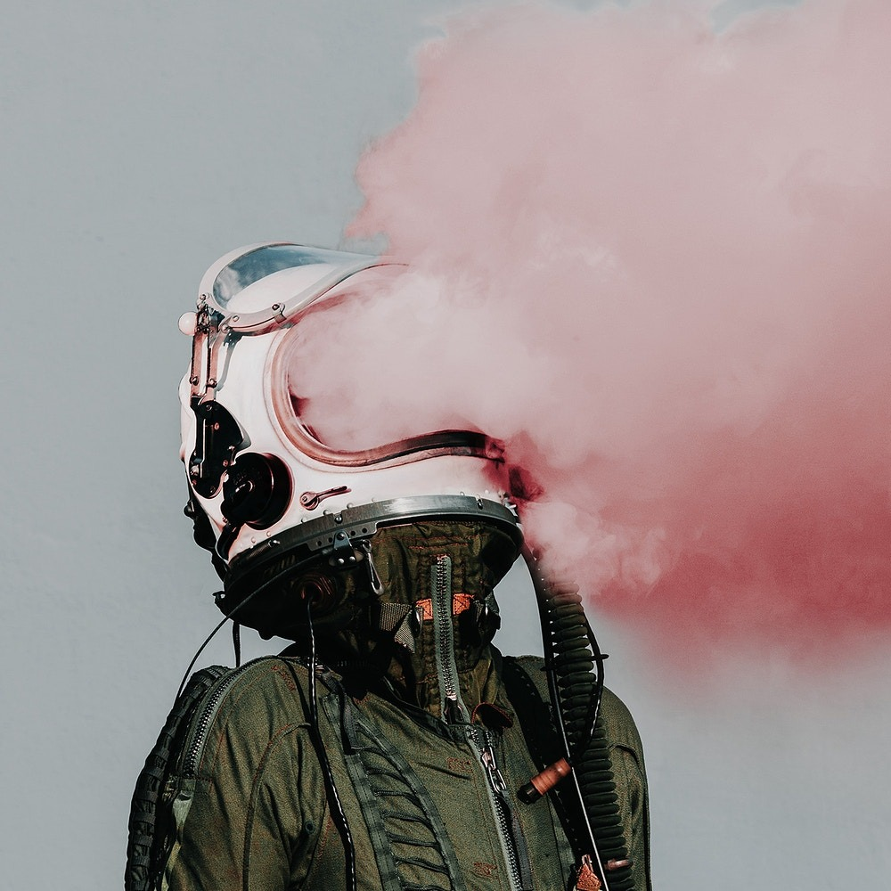 Man with smoke out of helmet
