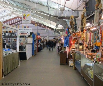 The interior booths sell all sorts of goods at the flea market.